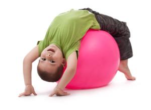 Little boy doing gymnastic exercises